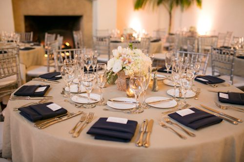 Soft Glow - creamy linens, navy napkins, silver accents, and ivory uplighting.  Can't go wrong!