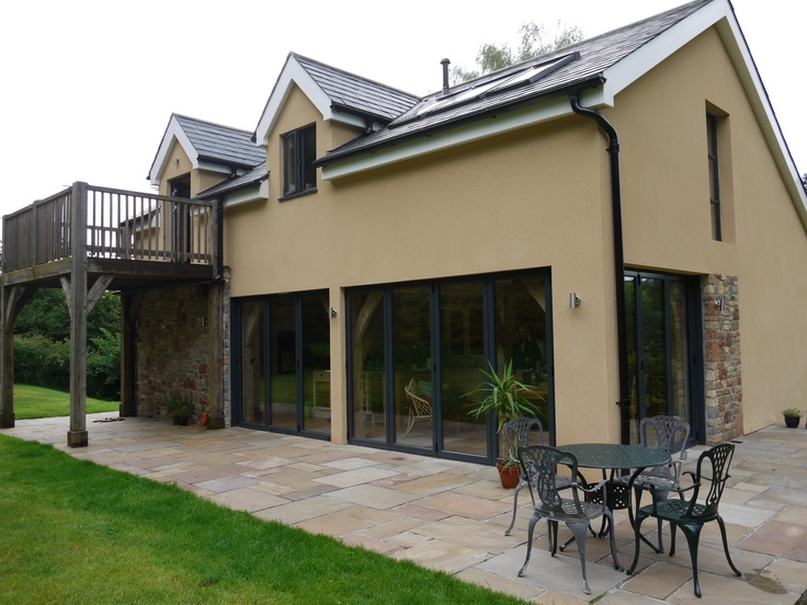 3 Sets of Bifolds installed to a lovely property, with matching aliuminium windows.