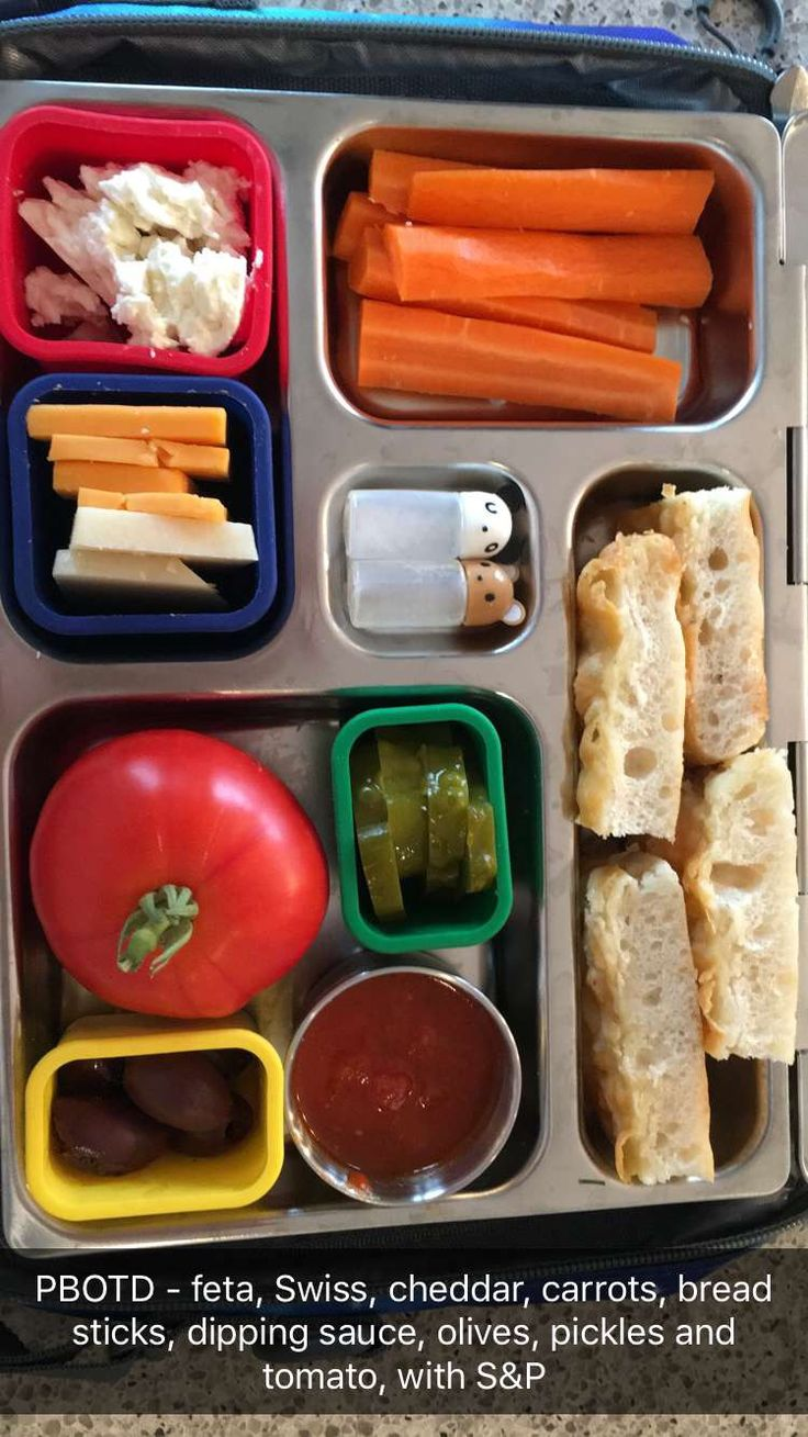 Planetbox - cheese, carrots, cheese bread, dipping sauce, olives, pickles, tomato and S&P