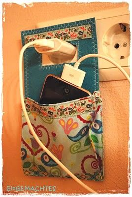 Phone charging pocket. I am so in love with this! Sometimes when I am staying not at home, the outlet is not near a place to set my phone!