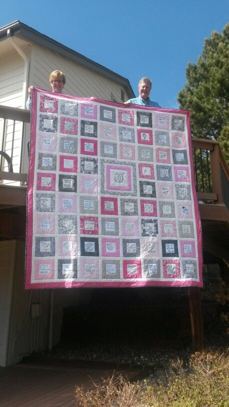 Wedding Guest Book quilt. I designed and made this quilt for a relative's wedding gift. Guests signed squares with pink or pewter borders. The center block is their monogram done in metallic pewter thread.