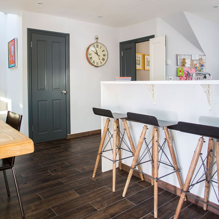 See how two awkward-shaped rooms were knocked through and an extension built to create a stylish and spacious open-plan kitchen-diner