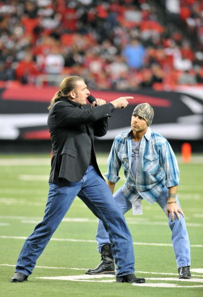 Wrestlers Triple H and Shawn Michaels attend the Baltimore Ravens vs Atlanta Falcons game at the Georgia Dome on November 11 2010 in Atlanta Georgia