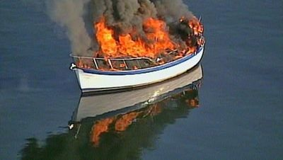 Chopper 7 was over a burning vessel in Port Orchard Bay.