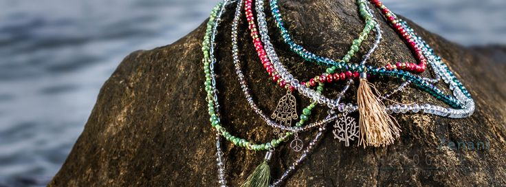 jewels on the beach, mai copenhagen, product photography in natural surroundiings, necklaces on beach rocks