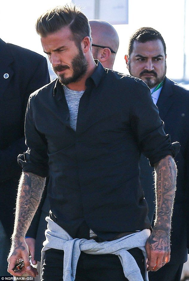 David Beckham shows off tattoos as he attends Super Bowl football game #dailymail