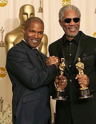 Best Actor Jamie Foxx (Ray) celebrates his Oscar win with Best Supporting Actor Winner Morgan Freeman (Million Dollar Baby)