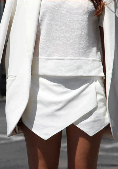 Add some drama to office or school wear with this jaw dropping white skort, featuring an asymmetric hemline covering the front. It also has two functional pockets with a zip closure at the back.Looks perfect with a chiffon blouse and sky-high heels.