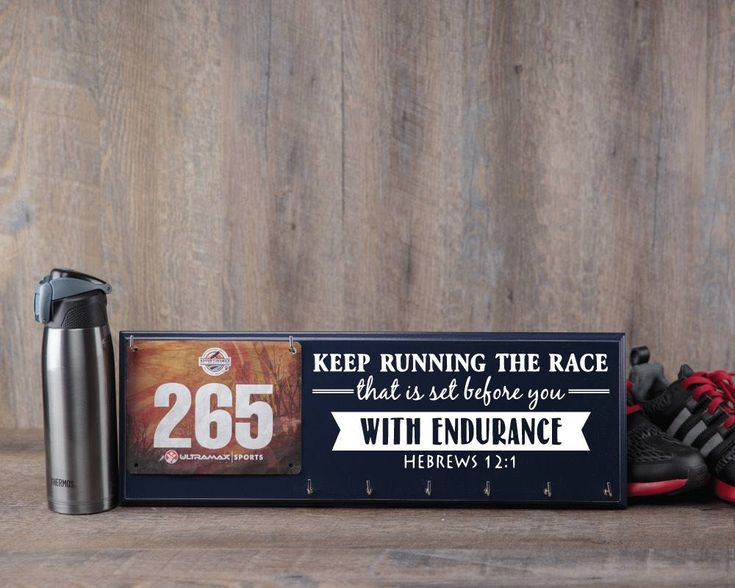Running Medal Holder and Race Bib Hanger - Hebrews 12:1 - Keep Running the Race. This running medal holder is the perfect way to Strut Your Stuff for all to see. Creating this medal display is done in numerous steps. We begin with routing, sanding, drilling and priming. Then we