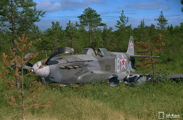 "A Finnish soldier sits in a Soviet single seater Yak-9 fighter of the 29 Gv.IAP, 275 IAD, 13th Air Army, which crashed landed near Lappeenranta in Finland on 30th August 1944 (photo taken on 2nd September) It's occupants were, Pilot Lt. Mikhail Volkov and his ""passenger"" Sub Lt. V.M. Titorenko who were both taken prisoner by the Finns."