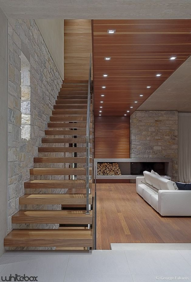 """""""Contemporary design home"""" Single open stringer design stair case, with fire place of far wall."""