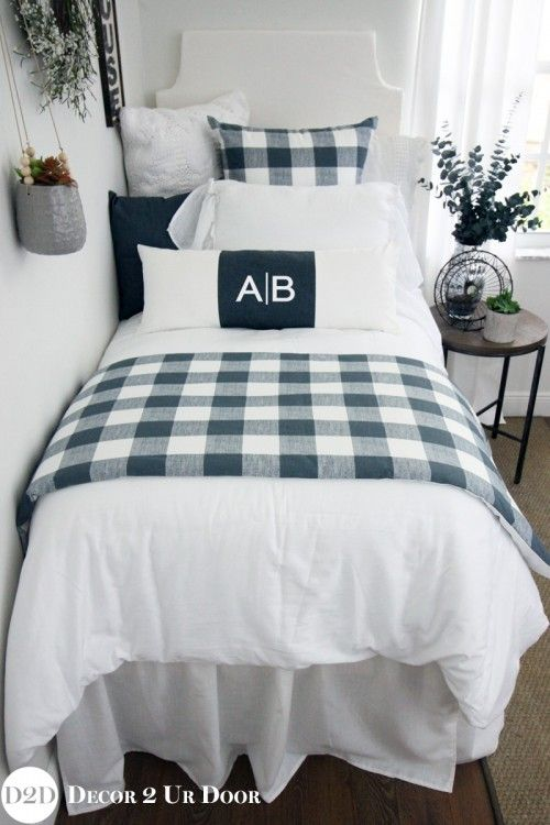 This farmhouse inspired gingham dorm room bedding set screams fixer upper style. We love the crisp and clean colors, frilly linens, and (of course) buffalo check plaid pattern.