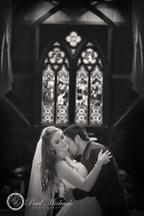 Kiss at St Pauls church. PaulMichaels Wellington wedding photography http://www.paulmichaels.co.nz/