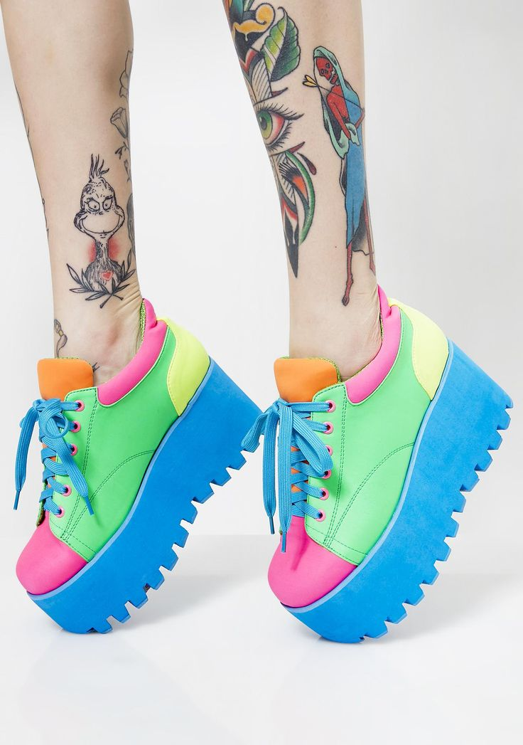 Current Mood Kandi Rush Platform Sneakers will have ya ridin' high on rainbowz. Keep it sweet af in these funky fresh neon platform sneakers that lace up with chunky soles and rounded toes.