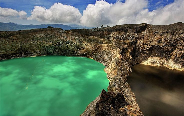 Color me Kelimutu: The Three Colored Lakes of Kelimutu, Flores!    Kelimutu is a volcano on the island of Flores. At 1,640 meters above sea level, the mountain forms the highest point on the island; Its main attractions are the three colored crater lakes. These mysterious lakes change color every so often...