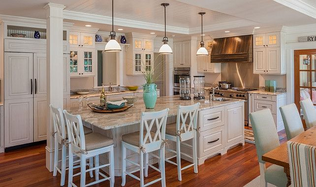 The kitchen features whitewash cabinets and a large kitchen island with quartzite countertop.