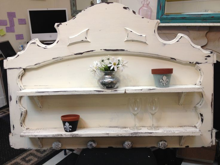old headboard, added shelves and antique doorknobs!