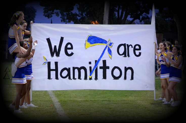 Football Run Through signs: We are Hamilton: School Name with Tomahawk emblem sitting on top of letters. #smalltownsmallschoolbighearts