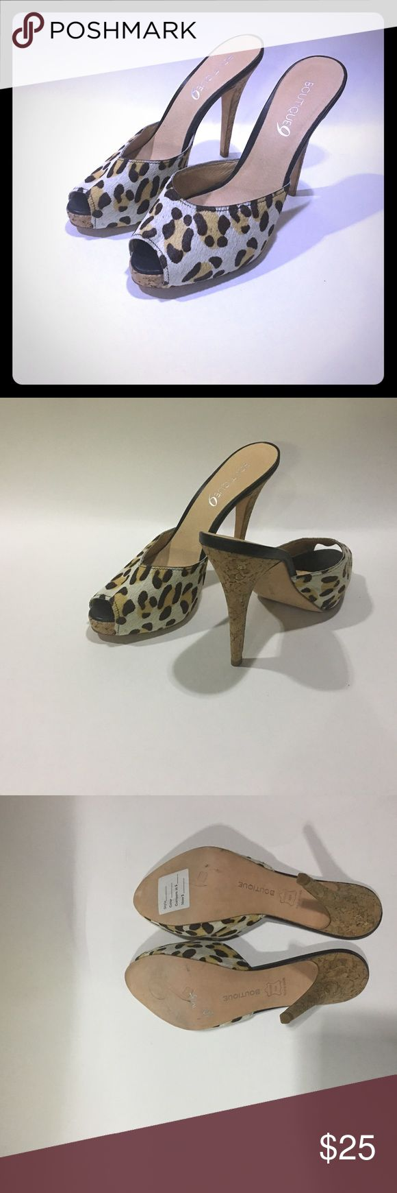 """Boutique 9 Pony Hair Animal Print Heeled Sandals This is a pre-owned pair of Boutique 9 size 10 heeled sandals.  The sandals have a cheetah animal print design that has a fur like texture and the heel is made of cork.  Cork shows some lines / scuffs/ etc due to storage.  Heel height approximately 5.5"""".  Leather sole.  Made in Brazil. Boutique 9 Shoes Heels"""