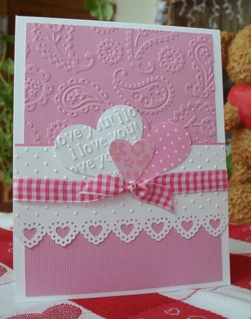 handmade Valentine card ... pink & white ... lots of embossing folder texture ... die cut hearts ... gingham bow ... heart MS edge punch ... lovely!!!