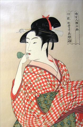 A Woman Playing a Poppin |Utamaro