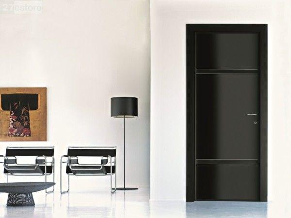 Interior Black Doors Using Brushed Chrome Door Handles Mounted on White Wall Paint of De...