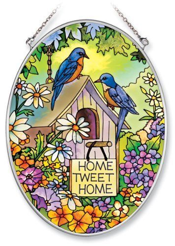 Amia Hand Painted Glass Suncatcher with Home Tweet Home Birdhouse Design, 5-1/4-Inch by 7-Inch Oval by Amia. $19.00. Includes chain. Comes boxed, makes for a great gift. Handpainted glass. Amia glass is a top selling line of handpainted glass decor. Known for tying in rich colors and excellent designs, Amia has a full line of handpainted glass pieces to satisfy your decor needs. Items in the line range from suncatchers, window decor panels, vases, votives and m...
