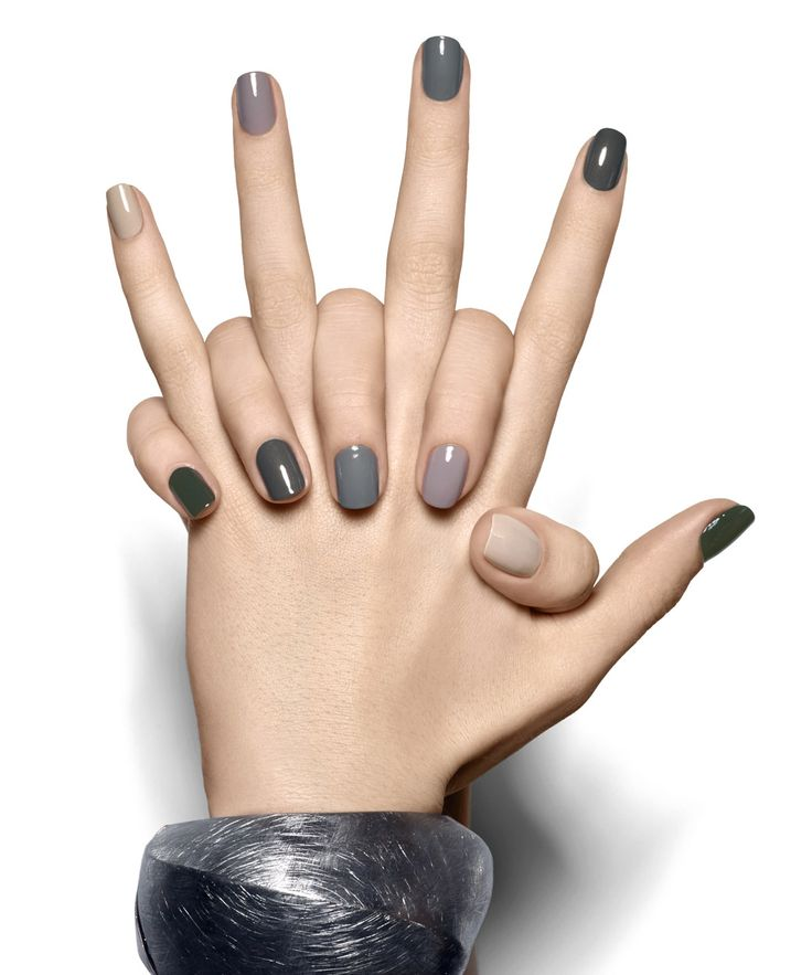This camouflage-ready miltary-inspired manicure marches from opulent dark green to soft sandy beige without missing a step. Essie's- Sand Tropez, Chinchilly, Sew Psyched, Armed and Ready and Stylenomics.