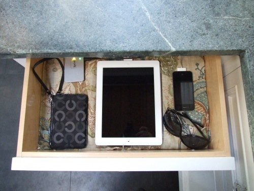 charging drawer for electronic devices - install power strip at back and leave room behind drawer for main cord to move