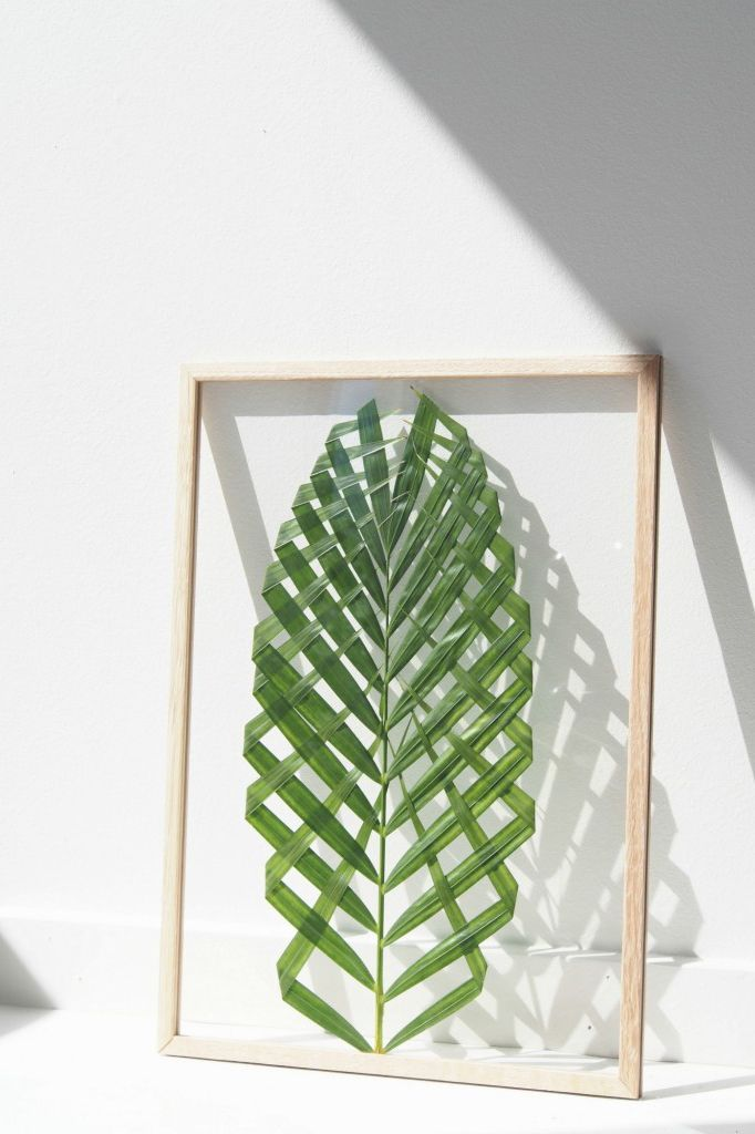 22 Summer-Perfect DIYs You Can Tackle This Weekend #refinery29 http://www.refinery29.com/summer-diy-projects#slide-5 Leaf Art By Monsters CircusA palm frond and a simple, wooden frame are all that's required for this eye-catching art piece. (Scroll through the original Danish for instructions in English.)