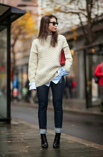 Dark blue jeans chunky sweater red clutch