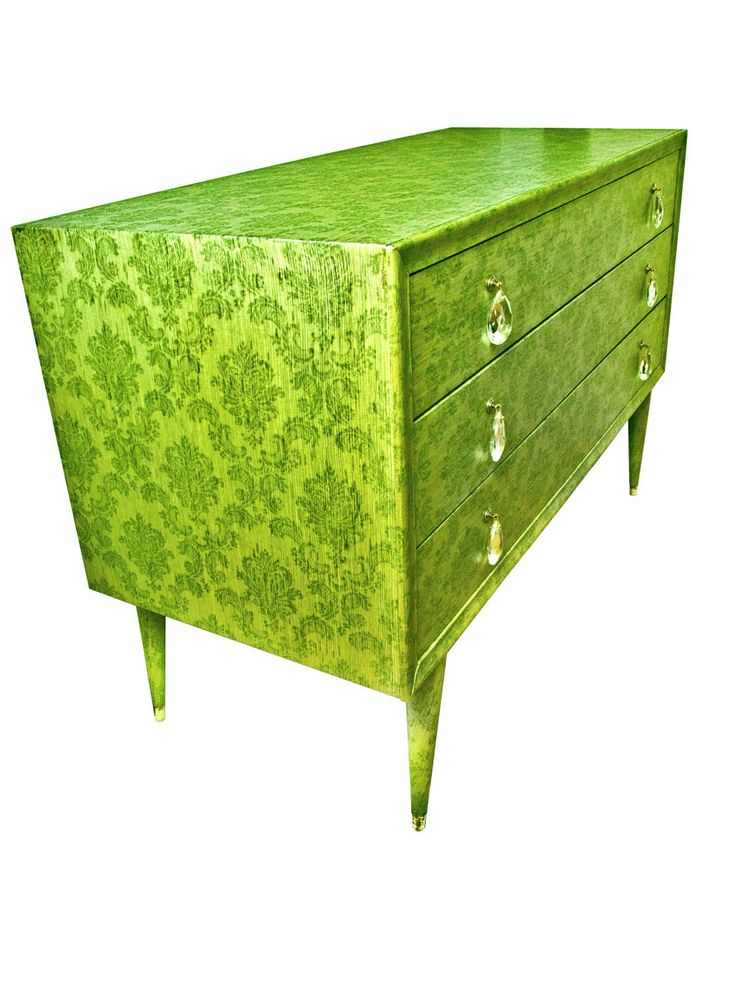 Dresser covered with green damask textile wallpaper