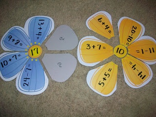 First Grade School Box: Subtraction Flower theme circle map. Answer in middle, problems on petals