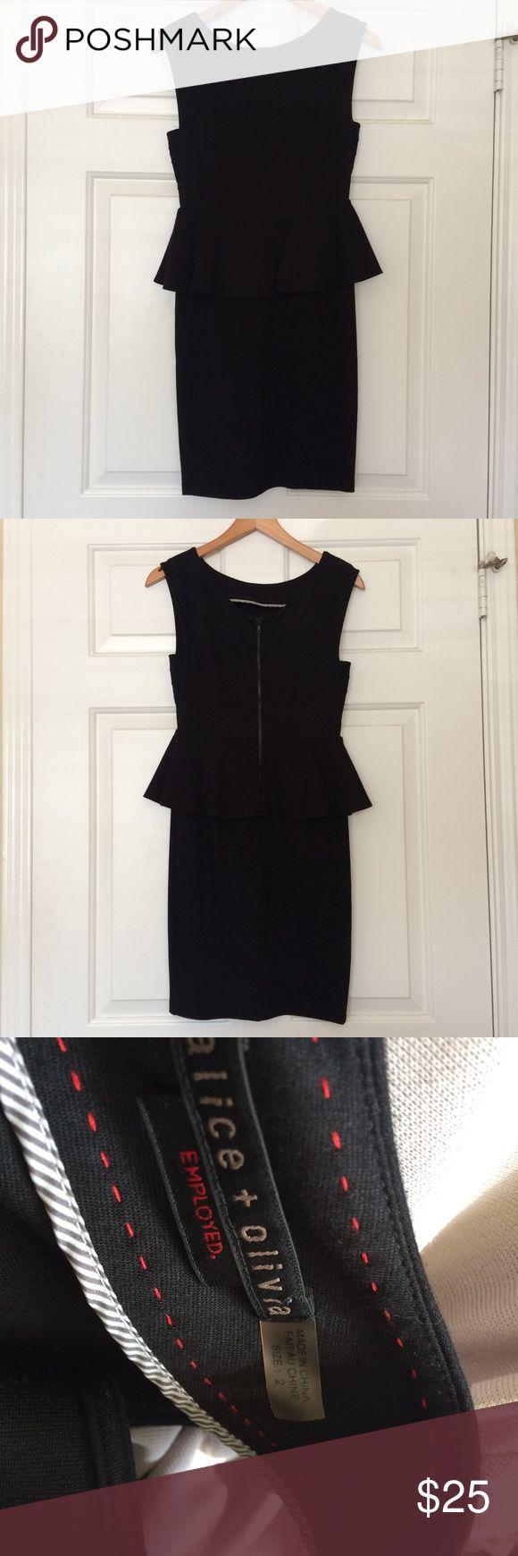 Alice + Olivia dress Alice + Olivia black peplum dress, zipper in back, quality  fabric is still in good condition Alice + Olivia Dresses