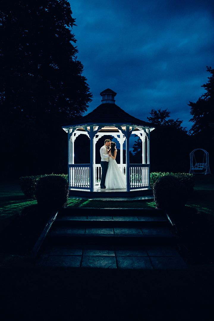 romantic evening wedding photo - love the bold blue sky against the crisp white gazebo!