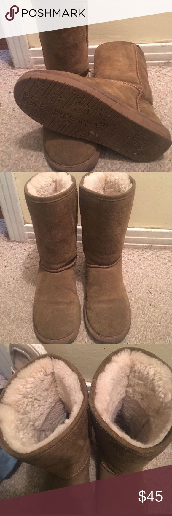Woman's bearpaw winter boots Size 8 runs small. I usually wear a 7 BearPaw Shoes Winter & Rain Boots