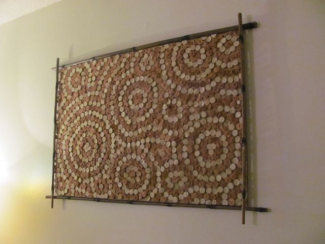 Wine cork art.  Would be cool to use red wine vs. white wine corks for a colour pattern as well.
