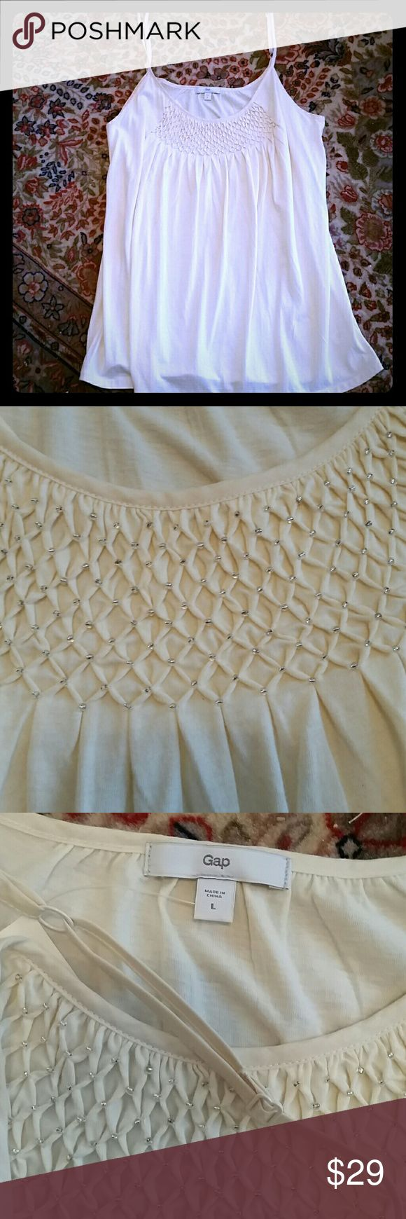 🌻🍁Beaded Camisole🍁 Lovely ivory camisole with smocking and tiny silver seed beads to accent the delicate pleats! Simple staple garment with pretty details!  The fit is relaxed yet sophisticated enough for under a jacket.  60%Pima cotton / 40%modal. GAP Tops Camisoles