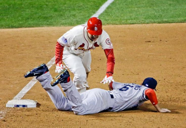 St. Louis Cardinals' Allen Craig gets tangled with Boston Red Sox's Will Middlebrooks during the 9th inning. Middlebrooks was called for obstruction on the play and Craig went in to score the game-winning run. The Cardinals won 5-4 to take a 2-1 lead in the series. (David J. Phillip/AP)