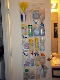 I never actually use those mesh shoe organizer things, heck my shoes hardly ever fit in them. Here is a wonderful way to organize your cleaning supplies and hang on your pantry door