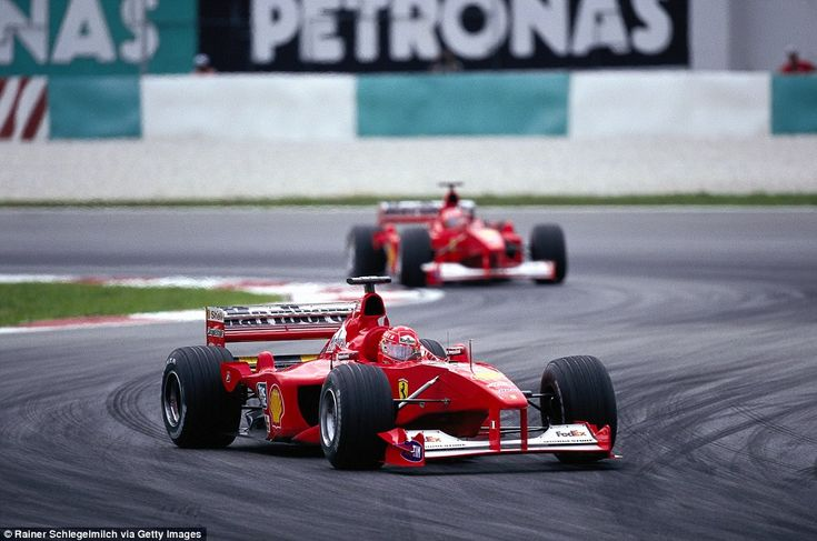 The start of a new century and it was Schumacher vs Hakkinen once again. It was third time lucky for the German as he clinched the first of his five straight world titles for the Italian outfit driving the F1-2000. Here the German leads his team-mate Rubens Barrichello at the season ending Malaysian Grand Prix at Sepang where the team won the constructors' crown giving them a first double since 1979