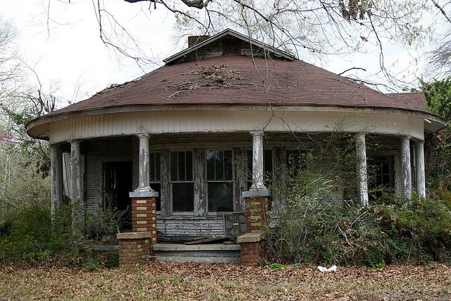 This gorgeous little house with a round porch was abandoned near Many, Louisiana.