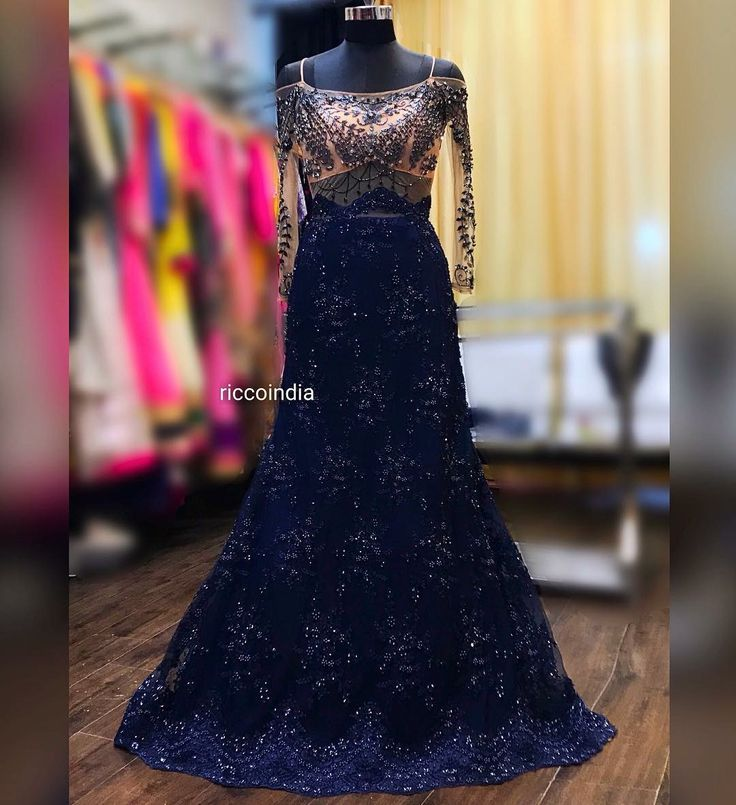 Very intricate hand work cocktail gown in fish cut with train