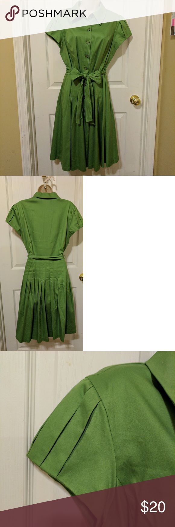 Kelly green dress This is a beautiful, vibrant green dress. It buttons up the front and has a pleated skirt. The belt ties in the front and the sleeves have flattering pleat details. Perceptions New York Dresses Midi