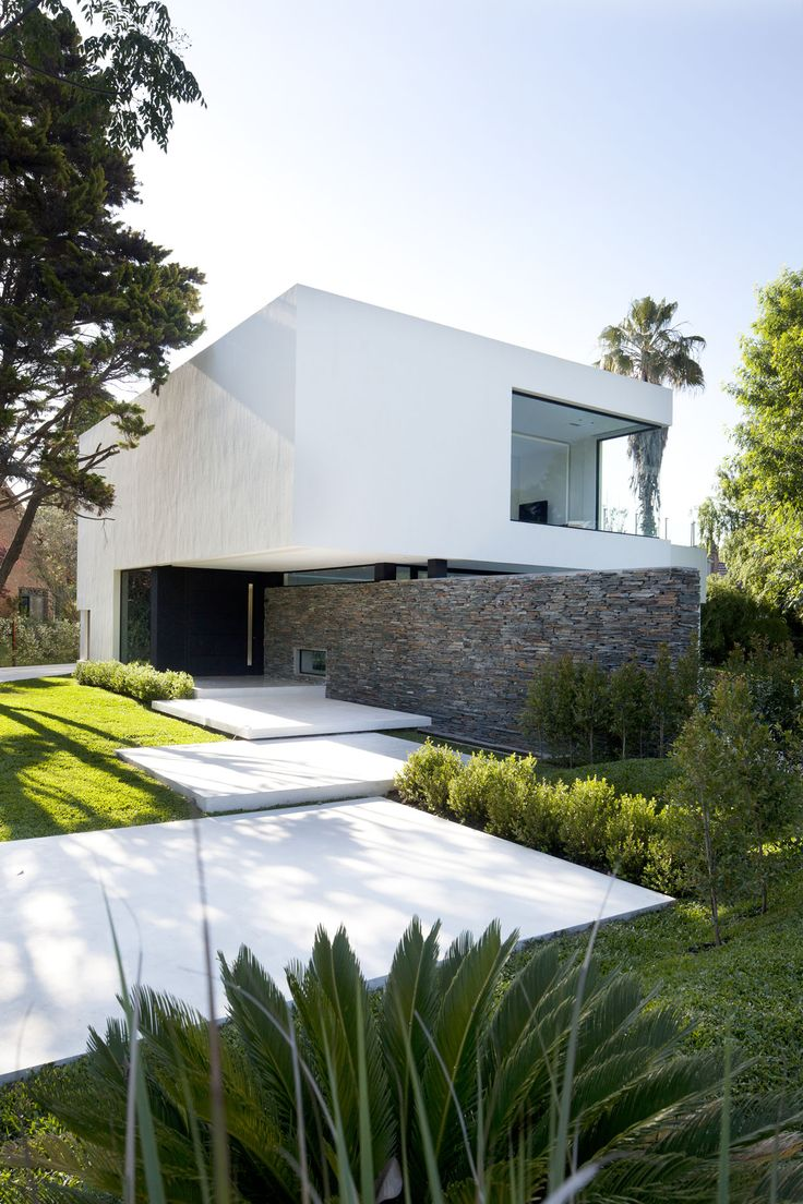 Simple modern white home with rectangular stairs