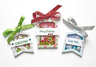 Created from the Holiday Shaker Tag Kit by Queen and Company.   Dress up your holiday presents this year with adorable shaker tags! This kit includes everything needed to create 9 fun shaker gift tags. These fun tags can be used on gifts or even on cards and scrapbook layouts.