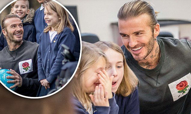 Beaming David Beckham delights young fans