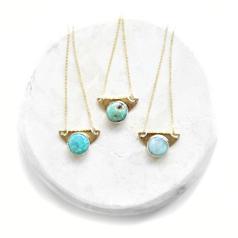 Turquoise SET pendant was handbuilt using .925 sterling silver and hand cut brass, soldered and refined with a round bezel set turquoise stone.