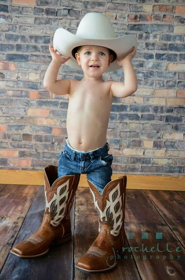 Those are some big boots, lil' cowboy! #littlecowboy #cowboyboots ...