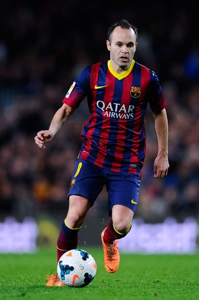 Andres Iniesta of FC Barcelona runs with the ball during the La Liga match between FC Barcelona and Rayo Vallecano de Madrid at Camp Nou on February 15, 2014 in Barcelona, Catalonia.